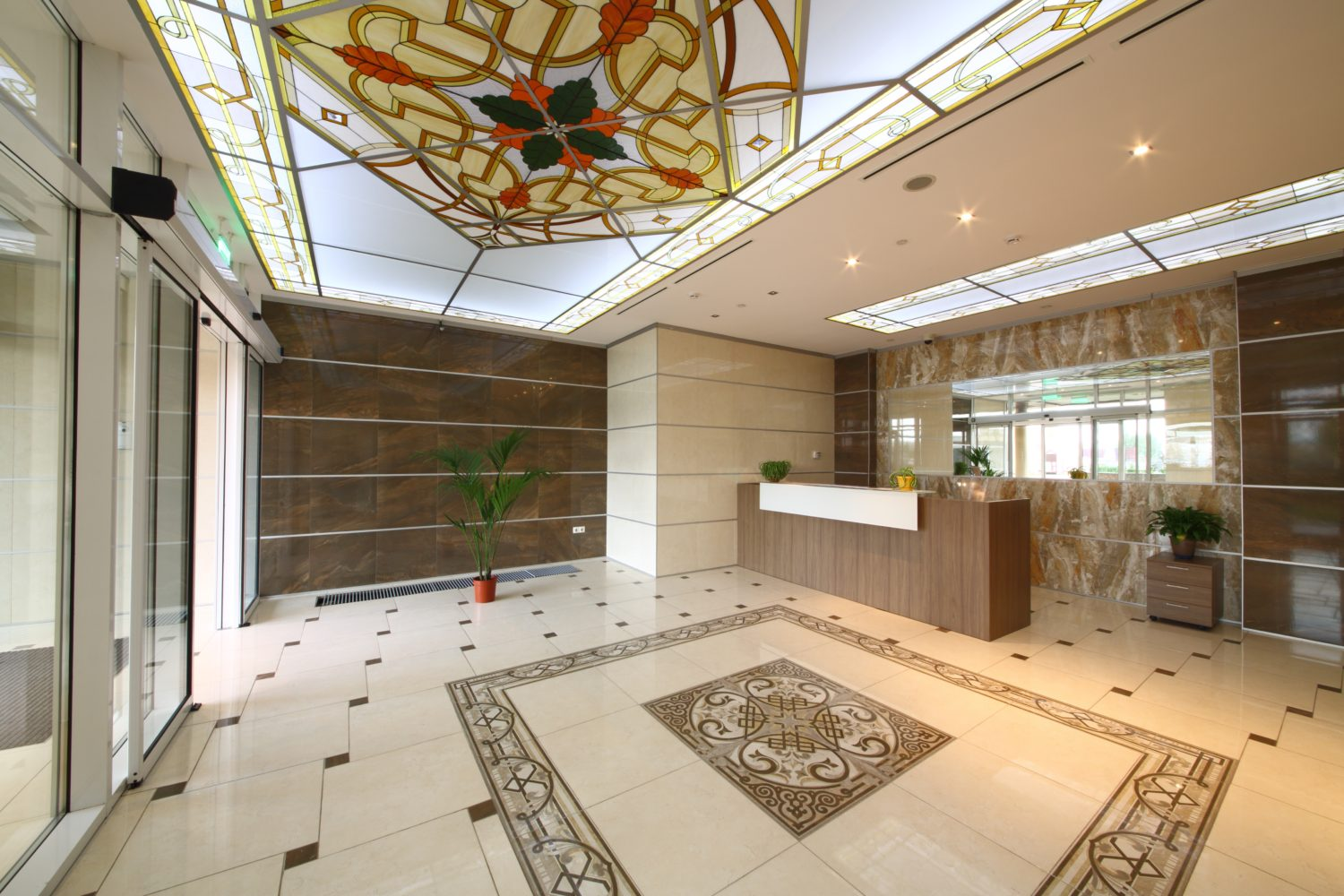 The elegant front with stained glass ceilings and granite floor